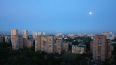 Evening on the town, the moon moves across the sky. Time lapse. - stock footage