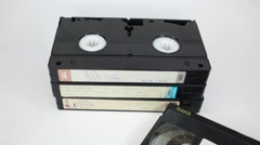 There is a stack of old video tapes on a white - stock footage