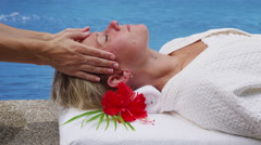 Woman at spa gets head massage - stock footage