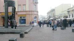 People come to the monument to Bulat Okudzhava on the Arbat Stock Footage