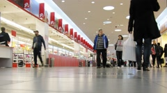 People in hall of a large modern shopping center Auchan Stock Footage