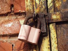 Pink padlock and iron shatter Stock Photos