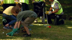 Stock Video Footage of Active family collecting rubbish in park