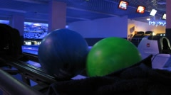 Close-up of bowling balls, they take people to the game Stock Footage