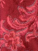 Velvet drapery embroidered with baroque ornament - stock photo