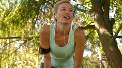 Fit blonde taking a break in the park - stock footage