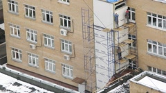 Construction of the elevator shaft near the building. Time lapse. - stock footage