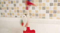 Childrens toy Drinking Bird moves on the table. Time lapse. Stock Footage
