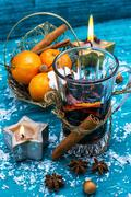 drink mulled wine on bright blue background. - stock photo