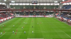Football teams play on the field of Locomotive sports arena - stock footage