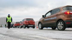 People sit on cars Ford and drive around site at Khodynka Field. Stock Footage