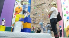 Children with special equipment climbing on walls Stock Footage