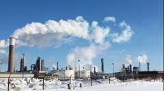 4K UltraHD Timelapse view of smoky pollutants pouring from a refinery Stock Footage