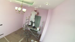 Worker to paint the walls of the room in pink. Time lapse. Stock Footage