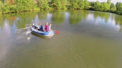 Four kids boys and little girls row on inflated boat Stock Footage