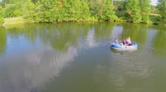 Four children boys and little girls sail on inflated boat Stock Footage