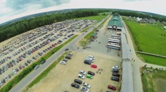 Large parking with many cars near cultural complex Etnomir Stock Footage