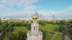 Temple of Protection in Fili and cityscape with skyscrapers Stock Footage