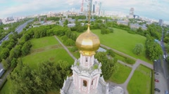 Cross on golden dome of church Pokrova in Fili and cityscape Stock Footage