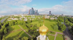 Cityscape with temple of Protection in Fili and skyscrapers Stock Footage