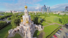 Urban scape with Church Pokrova in Fili and skyscrapers Stock Footage