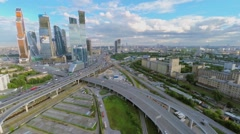Megalopolis with traffic on interchange near skyscrapers - stock footage