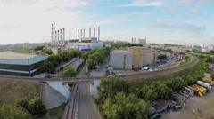 Urban industrial zone with railroad at summer day. Aerial view Stock Footage