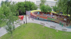 Children play on playground Kids Town in park named by Bauman - stock footage