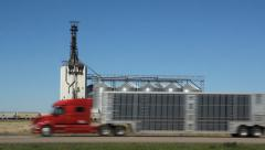 Grain elevator with train. Dunmore, Alberta, Canada. Red truck goes by. Stock Footage