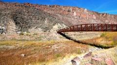 Rusty Metal Bridge, Grassy Plains, Rocky Canyon, Beautiful lake Stock Footage