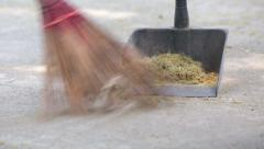 Man sweeping ground with a broom Stock Footage