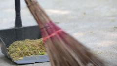 Man sweeping ground with a broom - stock footage