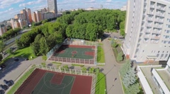 Cityscape with sports playgrounds at summer sunny day. Stock Footage