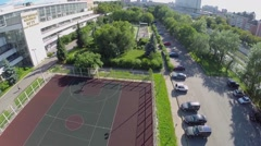 Cars parked near sports playgrounds of sports complex of MGTU Stock Footage