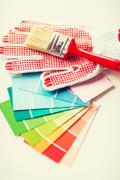 Paintbrush, gloves and pantone samplers Stock Photos