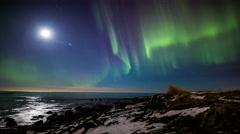 Moonlight ocean northern lights aurora, bright night Reykjavik, Iceland 4k Stock Footage