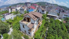 House among plants in south city at summer sunny day. Aerial view Stock Footage