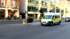 An ambulance off to rescue in the street in London Stock Footage