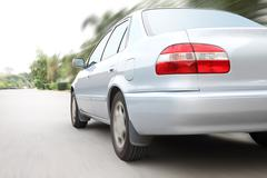 Speed driving a car on motion road. Stock Photos