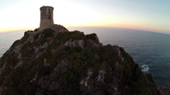 Flight over old tower in the sea at sunset. Corsica, France. Aerial view. Stock Footage