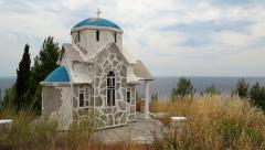 Small Greek temple on the hill near the Aegean Sea Stock Footage