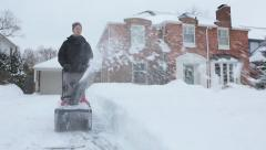 DRIVEWAY SNOW REMOVAL BLIZZARD SNOW STORM SNOW BLOWER Stock Footage