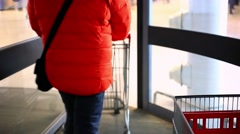 People go to the supermarket with shopping carts. Close up. HD. 1920x1080 Stock Footage