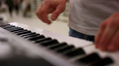 Closeup of male hands playing piano. Man Playing the synthesizer keyboard. HD Stock Footage