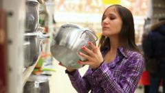 Woman with cart shopping buys a pan in supermarket at Kitchenware. HD, 1920x1080 Stock Footage