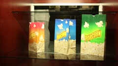 Movie Popcorn Intermission Display Stand Glass Case Popcorn Bag Stock Footage