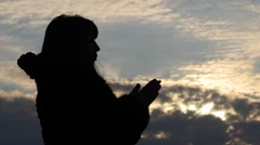 Silhouette of  woman making Christian pray with beautiful sky background Stock Footage
