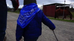 Grandpa and grandson walking, kicking the can Stock Footage
