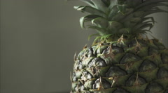 Close up of a Pineapple Turning (1 of 2) - stock footage