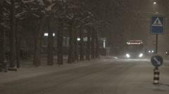Bus on snowy street in Winterthur Switzerland Stock Footage